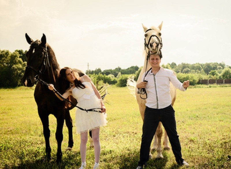 wedding of unusual couple happy near horses